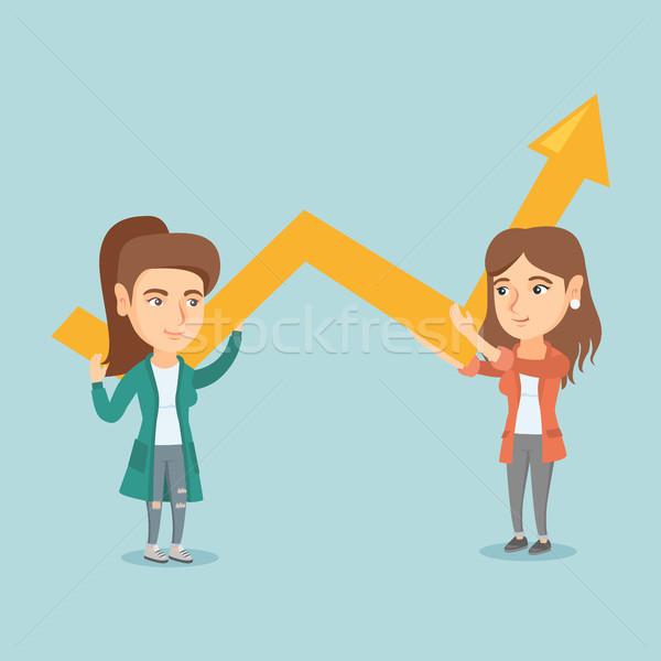 Dos jóvenes negocios mujeres crecimiento Foto stock © RAStudio
