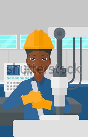 Woman working on industrial drilling machine. Stock photo © RAStudio