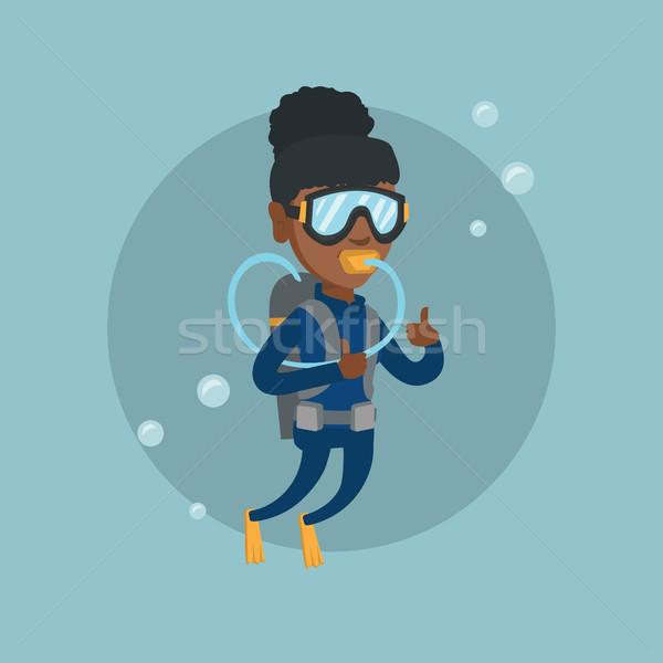 Young african-american scuba diver giving thumb up Stock photo © RAStudio