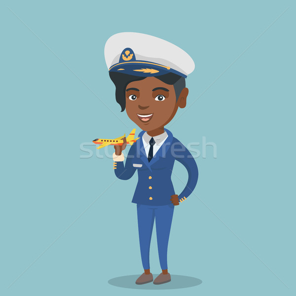 African airline pilot with the model of airplane. Stock photo © RAStudio