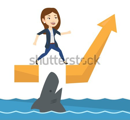 Business woman jumping over ocean with shark. Stock photo © RAStudio