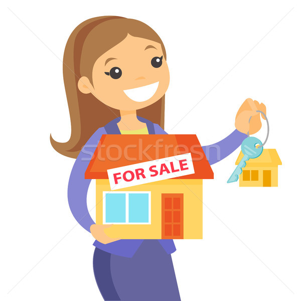 Caucasian white real estate agent holding key. Stock photo © RAStudio