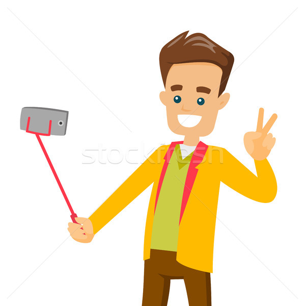 A white man making selfie on his cellphone with a selfie stick. Stock photo © RAStudio