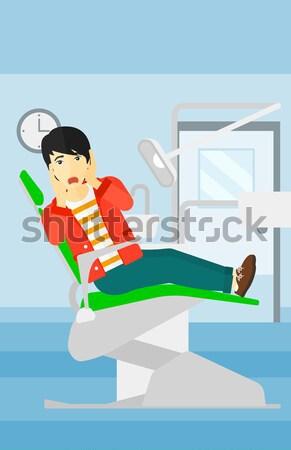 Frightened patient in dental chair. Stock photo © RAStudio