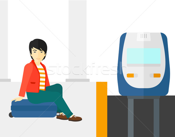 Man sitting on railway platform. Stock photo © RAStudio