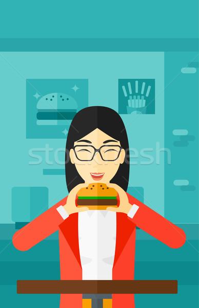 женщину еды гамбургер азиатских кафе вектора Сток-фото © RAStudio