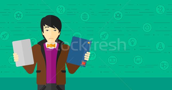 Man choosing between book and tablet computer. Stock photo © RAStudio
