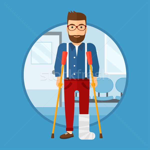 Man with broken leg and crutches. Stock photo © RAStudio