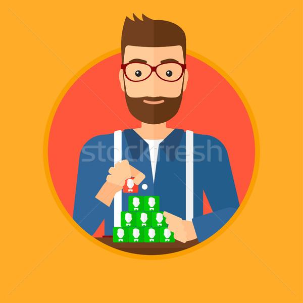 Man building pyramid of network avatars. Stock photo © RAStudio