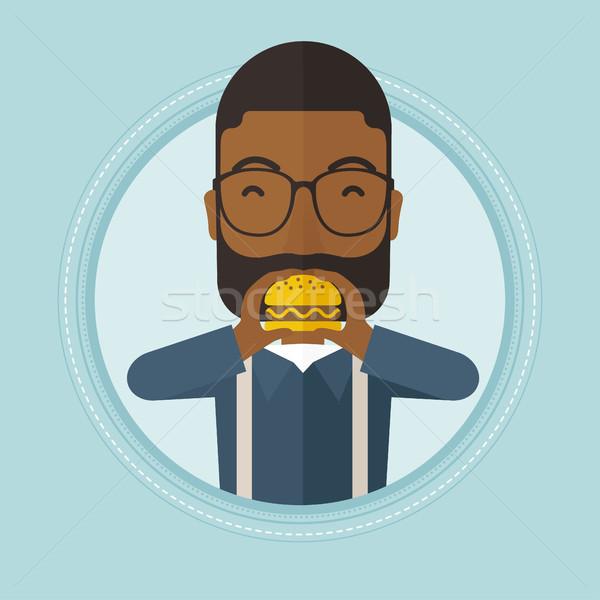 Man eating hamburger vector illustration. Stock photo © RAStudio