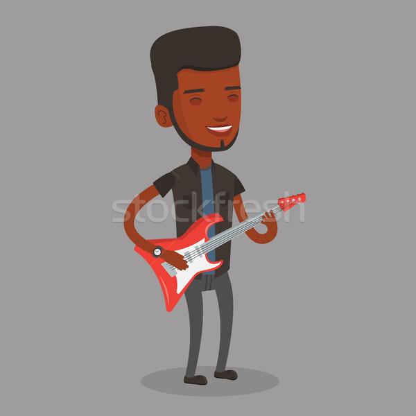 Férfi játszik elektromos gitár fiatal zenész boldog Stock fotó © RAStudio
