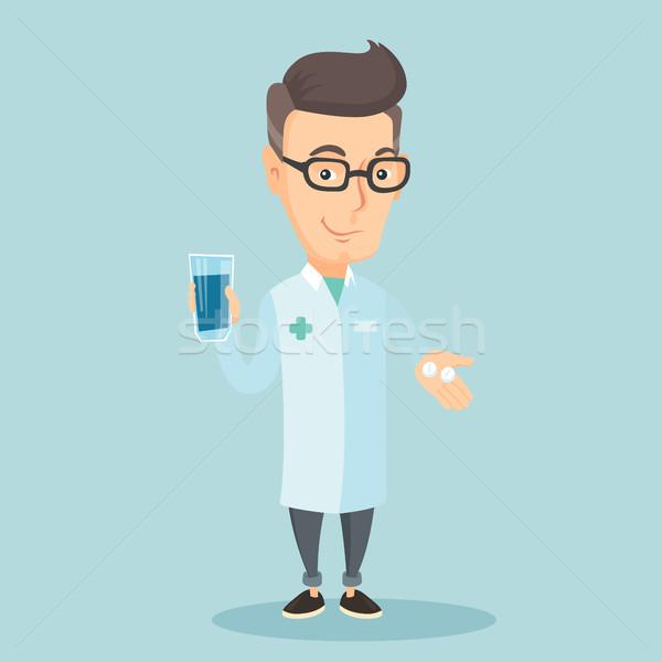 Pharmacist giving pills and glass of water. Stock photo © RAStudio