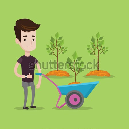 Vrouw voortvarend kruiwagen plant asian tuinman Stockfoto © RAStudio