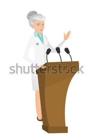 Doctor giving a speech from tribune. Stock photo © RAStudio