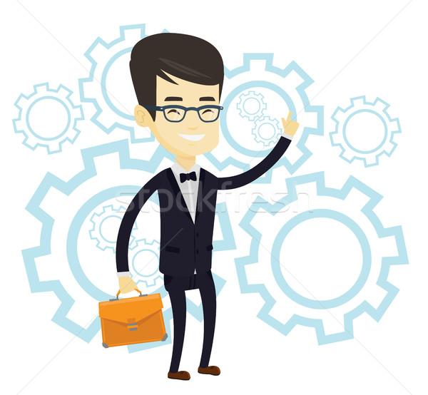 Sikeres üzlet ötlet ázsiai férfi mutat Stock fotó © RAStudio