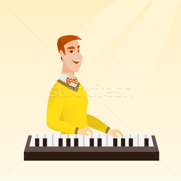 Férfi játszik zongora fiatal kaukázusi zenész Stock fotó © RAStudio