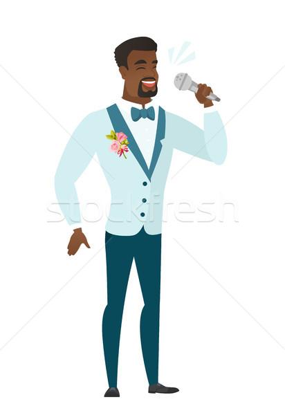 African-american groom singing to the microphone. Stock photo © RAStudio