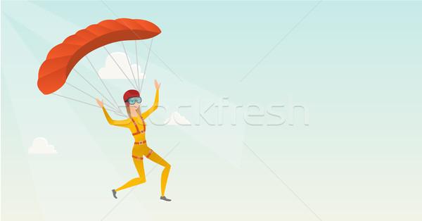 молодые кавказский Flying парашютом счастливым небе Сток-фото © RAStudio