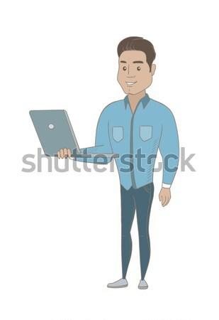 üzletember laptopot használ kaukázusi teljes alakos fiatal mosolyog Stock fotó © RAStudio