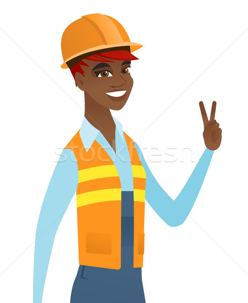 Młodych Afryki budowniczy zwycięstwo gest Zdjęcia stock © RAStudio