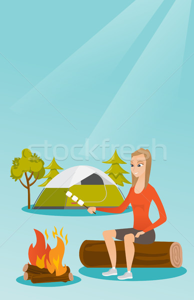 Caucasian girl roasting marshmallow over campfire. Stock photo © RAStudio