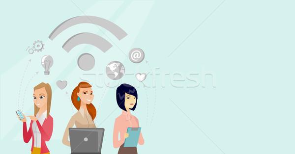Giovani business donne lavoro wifi simbolo Foto d'archivio © RAStudio
