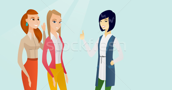 Stock photo: Young multicultural women sharing gossips.