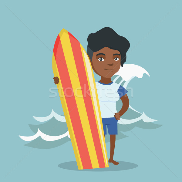 Young african-american surfer holding a surfboard. Stock photo © RAStudio