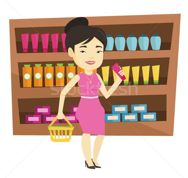 Customer with shopping basket and tube of cream. Stock photo © RAStudio