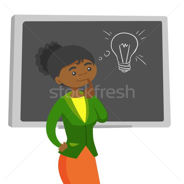 African student thinking about creative idea. Stock photo © RAStudio