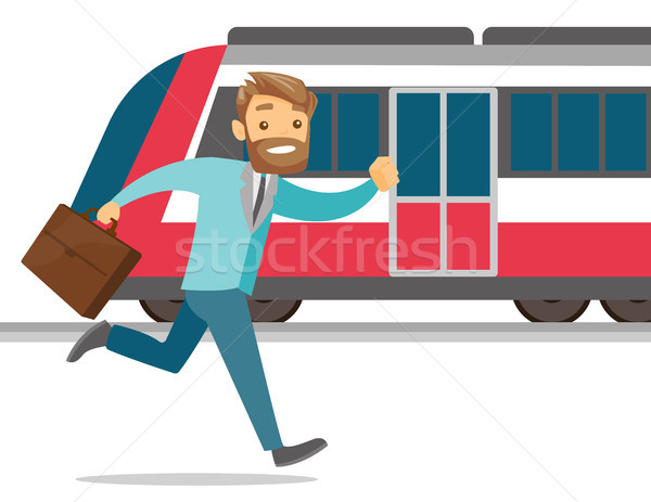 A man catching a missing train at the train station. Stock photo © RAStudio