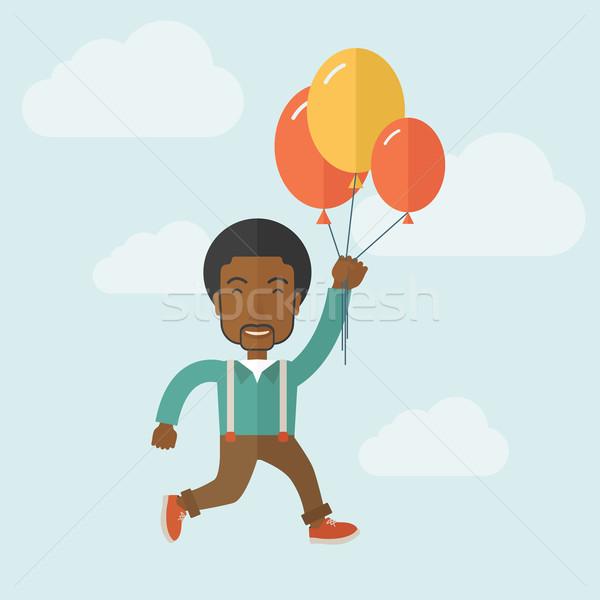 Genç siyah adam uçan balonlar mavi gökyüzü Stok fotoğraf © RAStudio