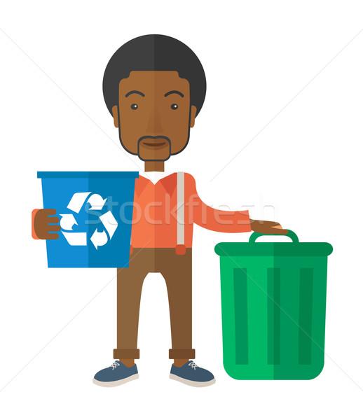 Black man sorting a trash Stock photo © RAStudio