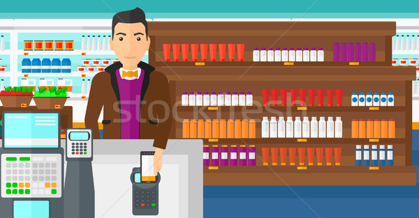 Customer paying with his smartphone using terminal. Stock photo © RAStudio