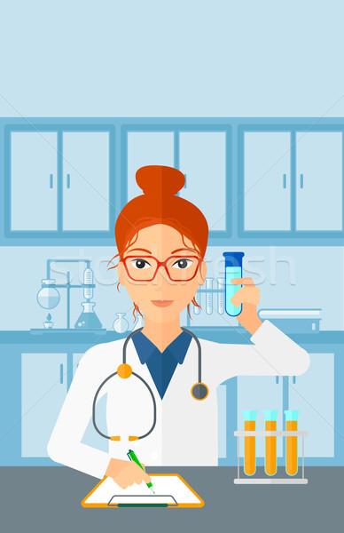 Laboratórium asszisztens dolgozik nő elvesz jegyzetek Stock fotó © RAStudio
