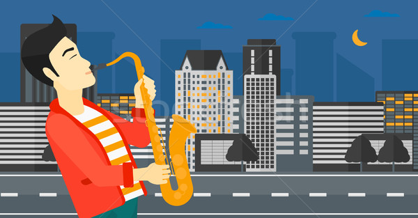 Musician playing saxophone. Stock photo © RAStudio