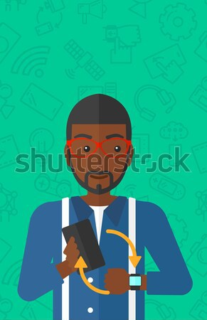Man with plant and wheelbarrow. Stock photo © RAStudio