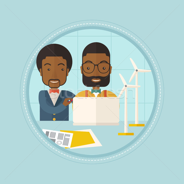 Engineers of wind farm working on laptop. Stock photo © RAStudio
