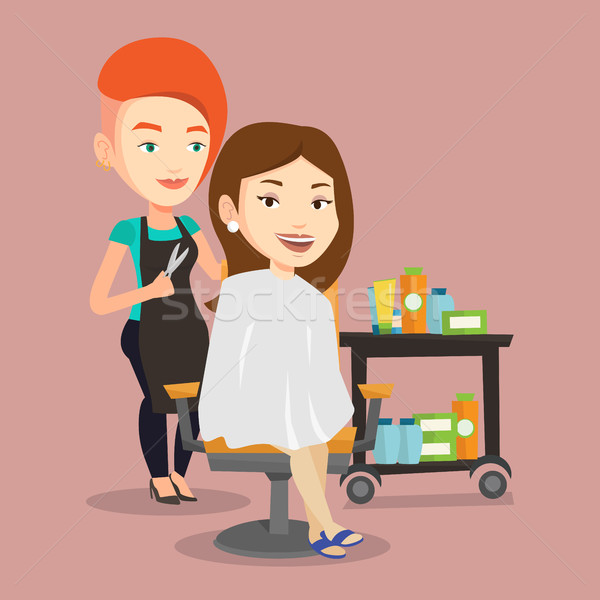 Hairdresser making haircut to young woman. Stock photo © RAStudio
