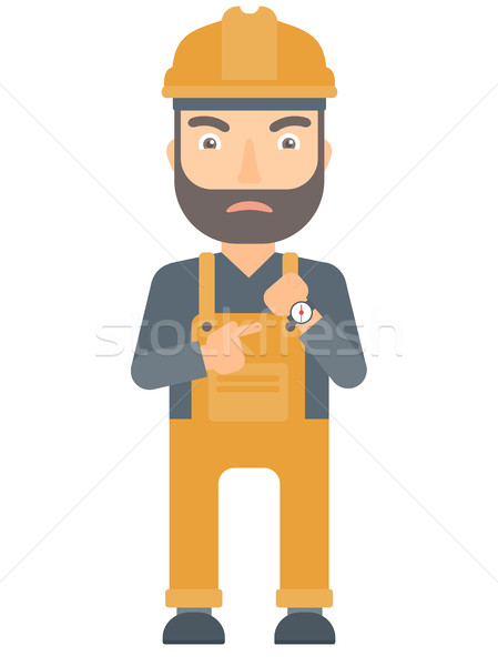 Angry constructor pointing at wrist watch. Stock photo © RAStudio