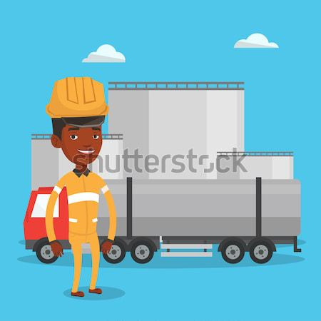 Worker on background of fuel truck and oil plant. Stock photo © RAStudio