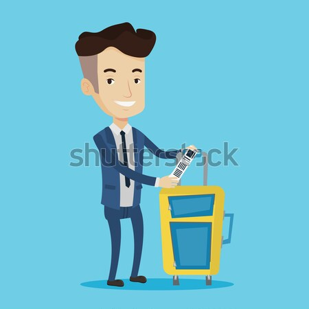 African-american business man showing luggage tag. Stock photo © RAStudio