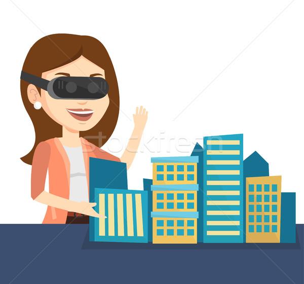 Szczęśliwy młoda kobieta faktyczny rzeczywistość zestawu Zdjęcia stock © RAStudio
