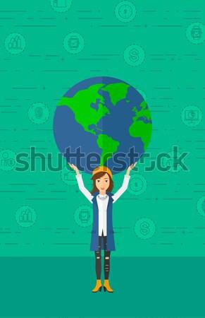 Business woman holding globe vector illustration. Stock photo © RAStudio
