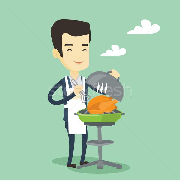Férfi főzés tyúk barbecue grill ázsiai kint Stock fotó © RAStudio