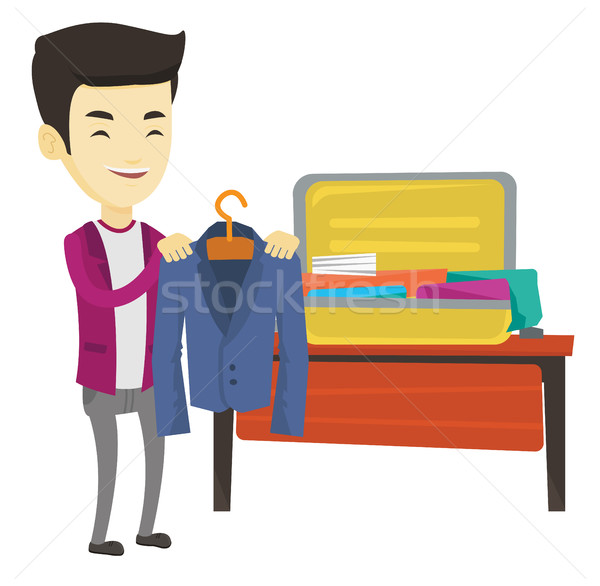 Jeune homme valise asian homme d'affaires costume Photo stock © RAStudio