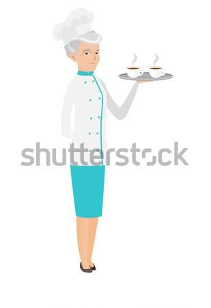 Senior caucasian chef holding tray with cups. Stock photo © RAStudio