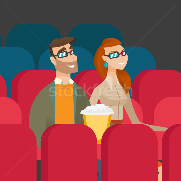Caucasian couple watching 3D movie in the theatre. Stock photo © RAStudio