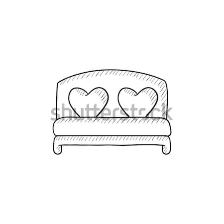 Heart shaped pillows on bed sketch icon. Stock photo © RAStudio