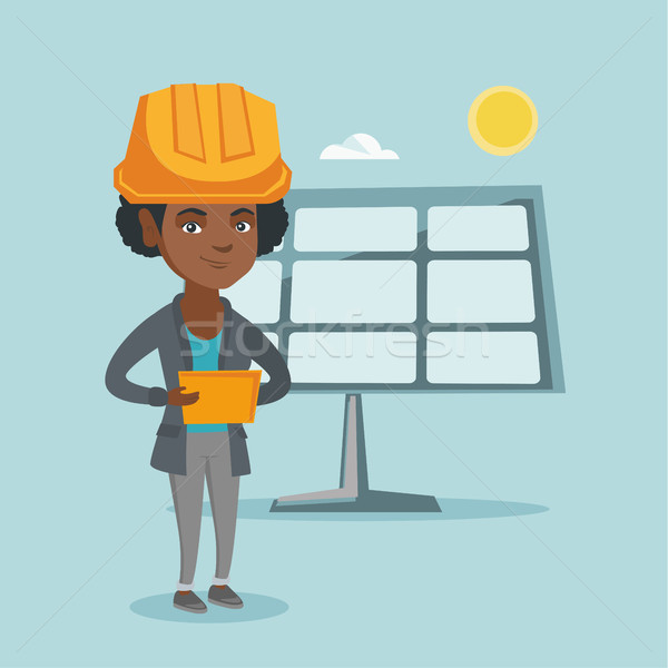 Worker of solar power plant using digital tablet . Stock photo © RAStudio
